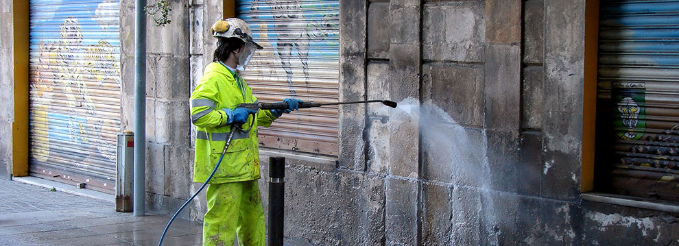 Graffiti removal worker
