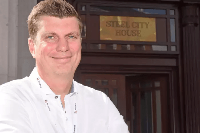 Image of Founder Nic Breteton outside the new building, Steel City House